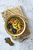 Ramen soup with soba noodles, chicken and seaweed (Japan)