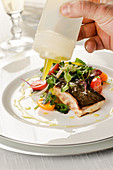 Turbot fillet with side salad, drizzled with olive oil