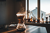 Drip coffee maker on table