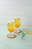Beer punch with soda, peach liqueur and apricots