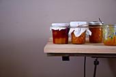 Orange jam and orange-strawberry jam in glasses on a table