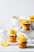 Lemon Cupcakes with Cream Cheese Frosting and Pineapple Flowers