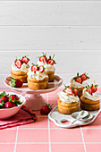 Vanilla Cupcakes with Cream Cheese Topping and Fresh Strawberries