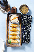 Fried gyoza with soy sauce and mayonnaise