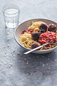 Spaghetti with tomato sauce and vegan tofu meatballs