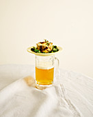 Petatou (French potato casserole with goat cheese) and a mug of beer