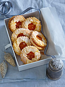 Christmas cookies with jam and almond flakes