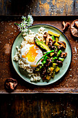 Green asparagus with poached egg, shiitake mushrooms, and sesame seeds