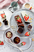 Brownie cubes decorated with chocolate and fresh strawberry