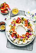 Pavlova with passion fruit and strawberries