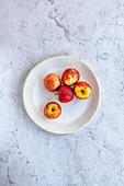 Envy apples on a decorative ceramic plate