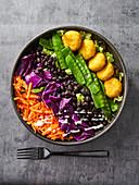 Buddha bowl with millet patties (vegan)
