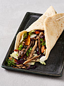 Autumn wrap with red cabbage, pumpkin, and fried mushrooms (vegan)
