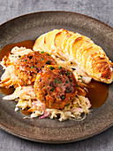 Vegan potato gratin with sauerkraut and vegetable cakes