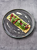 Herbal pancakes with baby spinach, beetroot, and tofu cream