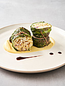 Savoy cabbage roulade on turnip puree with red wine jus (vegan)