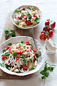 Penne with fresh cherry tomatoes, salted ricotta, olives, mint