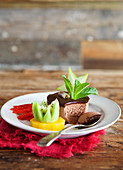 Thai chocolate dessert with fruit garnish