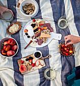 Picnic with peaches, nectarines, chorizo, cheese, pistachios, artichokes, blackberries and cherries