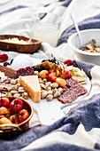 Picnic with peaches, nectarines, chorizo, cheese, pistachios, blackberries and cherries