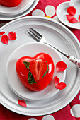 Heart-shaped strawberry dessert topped with jelly