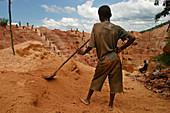 Boy working in a gold mine, Democratic Republic of Congo