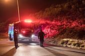 Firemen attempting to create a firebreak