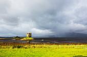 View of island castle on a lake, Scotland, UK