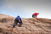 Rock climbers on a crag, Scotland, UK