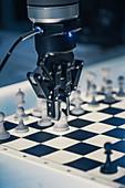 Robotic arm playing chess
