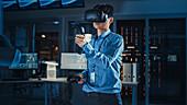 Engineer using augmented reality headset and joysticks