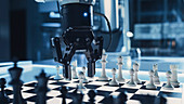 Robotic arm in a game of chess against a human