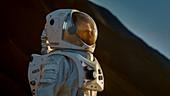 Astronaut looking around an alien planet