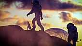 Silhouettes of two astronauts exploring a red, alien planet