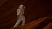 Astronaut going up a mountain to explore a red planet