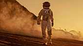 Astronaut walking on the surface of alien planet
