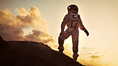 Silhouette of an astronaut standing on a mountain