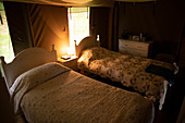 Quilts on beds in yurt cabin