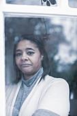 Sad woman at a window