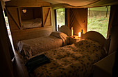 Beds with quilts in yurt cabin