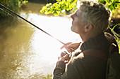 Man fly fishing at a river