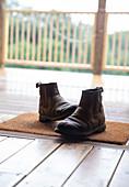Boots on doormat in cabin doorway