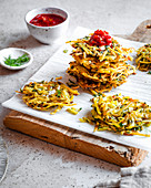 Stack of Moroccan Spiced Fried Hashbrowns with Harissa Sauce