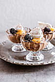 Classic chocolate mousse with whipped cream and lemon curd