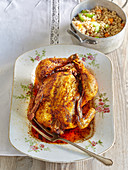 On china plate baked chicken with groats risotto