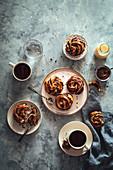 Chocolate babka knots and coffee on a breakfast table