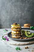Mini pancakes with kiwi fruit and ricotta