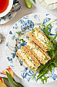 A plate of three egg mayonnaise sandwiches served with afternoon tea