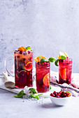 Fruit cocktail with apples, cranberries, oranges and basil