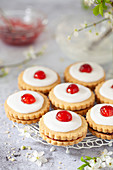 Jam filled shortbread Empire cookies on a small wire rack